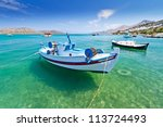 fishing boats at the coast of... | Shutterstock . vector #113724493