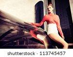 vogue model posing over big... | Shutterstock . vector #113745457