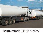 white tank trucks on the road ...   Shutterstock . vector #1137775097