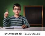 Seven year old boy looking forward to be scientist - stock photo