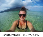 young happy tourist woman... | Shutterstock . vector #1137976547