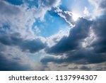 fluffy rain clouds before rain...   Shutterstock . vector #1137994307