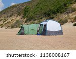 tourist tent on the sand.... | Shutterstock . vector #1138008167