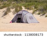 tourist tent on the sand.... | Shutterstock . vector #1138008173