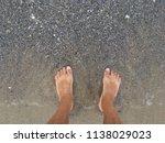 legs in sand beach sea coast... | Shutterstock . vector #1138029023