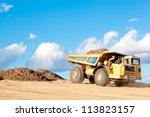 Heavy Dump Truck Unloads Soil...