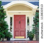 Magenta home door with arched top with two windows - stock photo