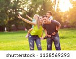 funny young parents giving... | Shutterstock . vector #1138569293