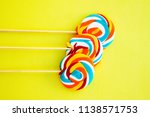 colorful hard candy lollipop on ... | Shutterstock . vector #1138571753