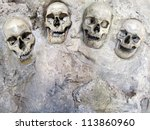 A display of cracked human skulls. - stock photo