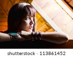 Beautiful girl looks out of the window. - stock photo