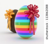 Two Easter Eggs with yellow and red ribbon. - stock photo