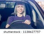 beautiful smiling woman driving ... | Shutterstock . vector #1138627757
