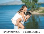 romantic couple playing... | Shutterstock . vector #1138630817