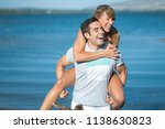 romantic couple playing... | Shutterstock . vector #1138630823