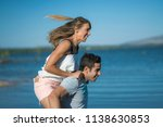 romantic couple playing... | Shutterstock . vector #1138630853