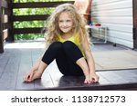 an adorable  smiling curly... | Shutterstock . vector #1138712573