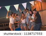 group of young friends having a ... | Shutterstock . vector #1138717553