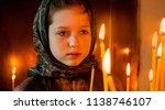 girl in a headscarf in church... | Shutterstock . vector #1138746107