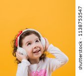 little girl in headphones on a... | Shutterstock . vector #1138753547