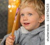 baby boy sitting in high chair... | Shutterstock . vector #1138756253