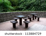 Table and chairs in the garden - stock photo