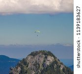 paraglider flying over the... | Shutterstock . vector #1139183627