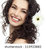 portrait of attractive  caucasian smiling woman brunette isolated on white studio shot flower - stock photo