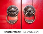 This image shows the detail on a Red temple door in chinatown, Singapore - stock photo