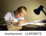 child learns at night - stock photo