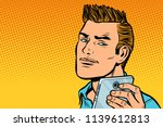 a serious man selfie. pop art... | Shutterstock .eps vector #1139612813