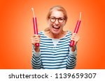 senior beautiful woman with a... | Shutterstock . vector #1139659307