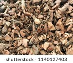 pile of dried coconut husk peel ... | Shutterstock . vector #1140127403