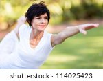 healthy middle aged woman doing ... | Shutterstock . vector #114025423