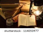 a bible surrunded by books in a ... | Shutterstock . vector #114053977