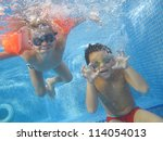 Two Boys Are Swimming...