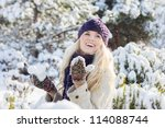 beautiful winter woman playing with snow - stock photo