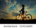 Biker Girl At The Sunset On Th...