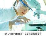serious female chemist working... | Shutterstock . vector #114250597