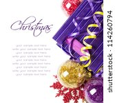 Red, purple and yellow xmas baubles with copy space - stock photo