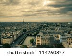 Small photo of View on Paris, HDR with moody sky from Notre Dame de Paris