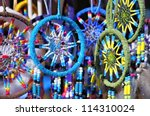 Fluffy variety of dream catchers on artisan market - stock photo