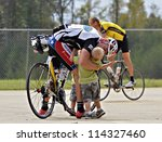 DAHLONEGA, GA/USA - SEPTEMBER 30: Unidentified man at the finish of the Three and Six Gap Century ride getting a hug from his children, September 30, 2012 in Dahlonega GA. - stock photo