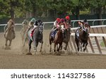 "ELMONT, NY - SEPT 29: The field for The Vosburgh Invitational turns for home at Belmont Park in Elmont, NY on Sept 29, 2012. Eventual winner is ""The Lumber Guy"" (gray roan at left). - stock photo"