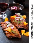 BBQ spare ribs marinated in orange sauce with herbs and wine - stock photo