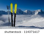 Skiing, winter season , mountains and ski equipment in the snow - stock photo