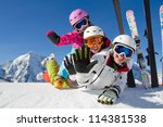 Winter, ski, snow and fun  - family enjoying ski holiday - stock photo
