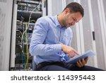 man using tablet pc beside... | Shutterstock . vector #114395443