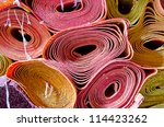 Pile of rolled mats - stock photo