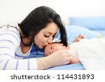 happy mother with her baby | Shutterstock . vector #114431893